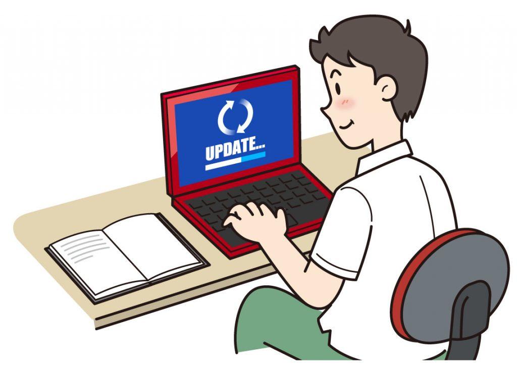 パソコンをアップデートしている男性のイラスト